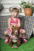 Girl sitting on dog — Stock Photo