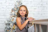 Pretty young girl dreaming of Christmas — Stock Photo