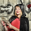 Stock Photo: Womin red dress and black cloak with hood on Halloween