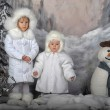 Two little girls in white coats and white fur hats — Stock Photo #37618387