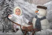 Girl on sleigh — Stock Photo