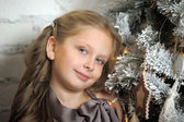 Girl near Christmas tree — Stock Photo