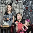 Mother and daughters dressed as Halloween witches — Stock Photo