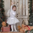Girl near Christmas fir-tree — Stock Photo #38044699