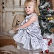 Girl near Christmas fir-tree — Stock Photo #38045137