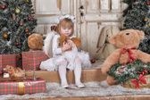 Girl near Christmas fir-trees — Stock Photo