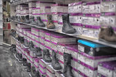 Shelves with shoes — Stock Photo