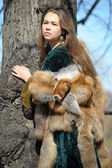 Woman in medieval dress and fox fur — Stock Photo