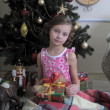 Stock Photo: Girl near Christmas fir-tree
