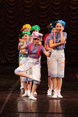 Children dancing on stage — Stock Photo