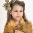 Girl in a gold — Stock Photo #39294599
