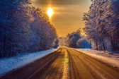 Winter road on sunset — Stock fotografie