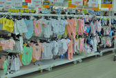 Shelves with baby clothes — Stock Photo