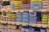 Empty plastic containers on the supermarket shelf. — Foto Stock