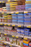Empty plastic containers on the supermarket shelf. — Foto de Stock