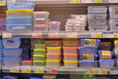 Empty plastic containers on the supermarket shelf. — Stock Photo