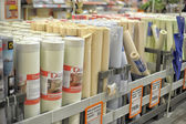 Rolls of wallpaper in the store — Stock Photo