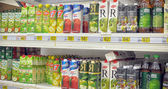 Juices on supermarket shelves — Stock Photo