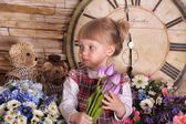 Little girl with a bouquet of tulips in hands — Stock Photo