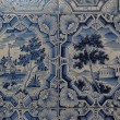 Blue white paintings on a tiled stove — Stock Photo #46783881