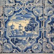 Blue white paintings on a tiled stove — Stock Photo #46783955