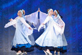 Girls in white dresses dancing on stage, Russian National Dance — Stock Photo