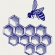 Royalty-Free Stock Photo: Working bee on honeycells