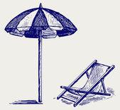 Chair and beach umbrella — Stock Photo