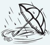 Rain drops rippling in puddle and umbrella — Stock Vector