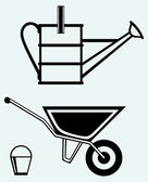 Garden wheelbarrow and watering can — Stock Vector