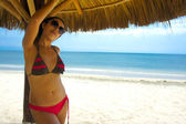 Woman under a Palapa — Stock Photo