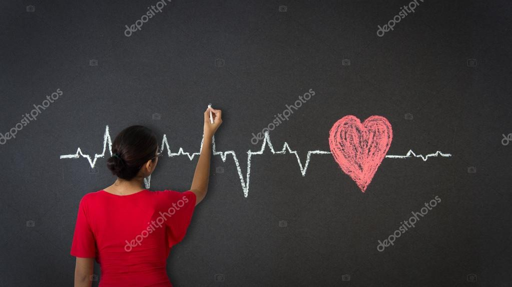 Woman drawing a Heartbeat Diagram with chalk on a blackboard. — Stock Photo #18592713
