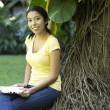 Young Woman using a laptop — Foto de Stock
