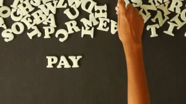 A person spelling Pay Per Click with plastic letters