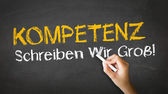 Competence Slogan (In German) — 图库照片