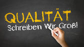 Quality Slogan (In German) — Stockfoto