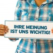 图库照片: Your opinion matters (In german)
