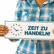 Stock Photo: Time For Action (In German)