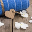 Rolled up towel and paper heart — Stock Photo