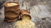 Brown rice bags — Stock Photo