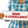 Stock Photo: Dedicated To Excellence (In French)