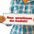 We Deliver Results (In French) — Lizenzfreies Foto