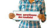 We Deliver Results (In French) — ストック写真