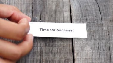 A Time for success paper sign on wood background