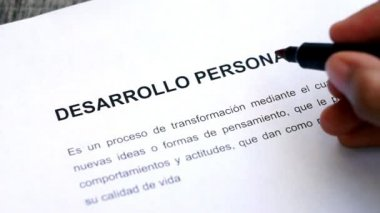 Circling Personal Development with a pen (In Spanish) — Stock Video