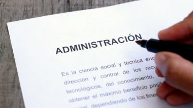 Circling Administration with a red marker (In Spanish) — Stock Video