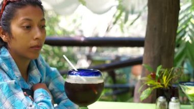 Young woman enjoying a drinnk — Stock Video