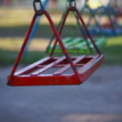 Stock Video: Empty swing in children's playground