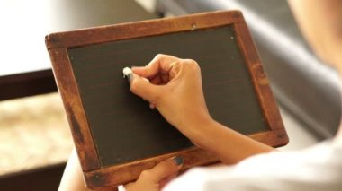 Woman writing one plus one — Video Stock
