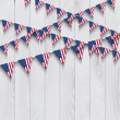 Flag bunting on wooden background — Stock Photo
